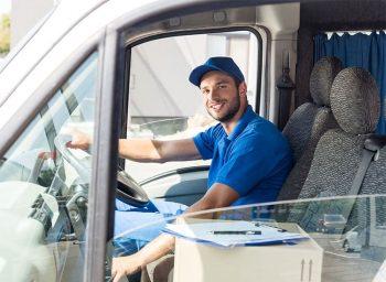 happy-salt-delivery-man-sitting-in-van